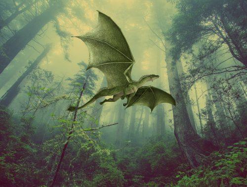 Immense dragon vert dans une forêt luxuriante